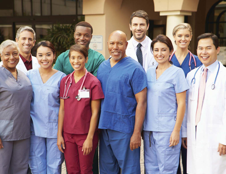 Health care team group photo in scrubs.